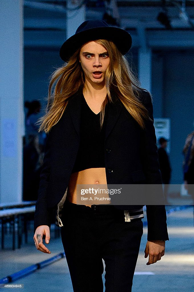 Model <a gi-track='captionPersonalityLinkClicked' href=/galleries/search?phrase=Cara+Delevingne&family=editorial&specificpeople=5488432 ng-click='$event.stopPropagation()'>Cara Delevingne</a> walks in the run through for the Giles show at London Fashion Week AW14 on February 17, 2014 in London, England.