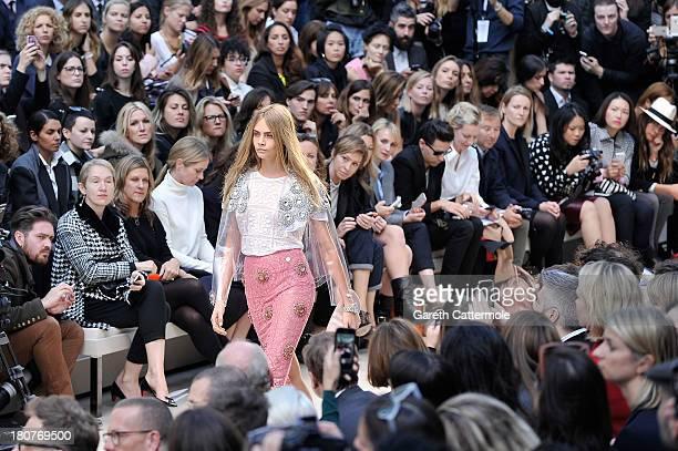 Model Cara Delevingne walks the runway at Burberry Prorsum Womenswear Spring/Summer 2014 show during London Fashion Week at Kensington Gardens on...