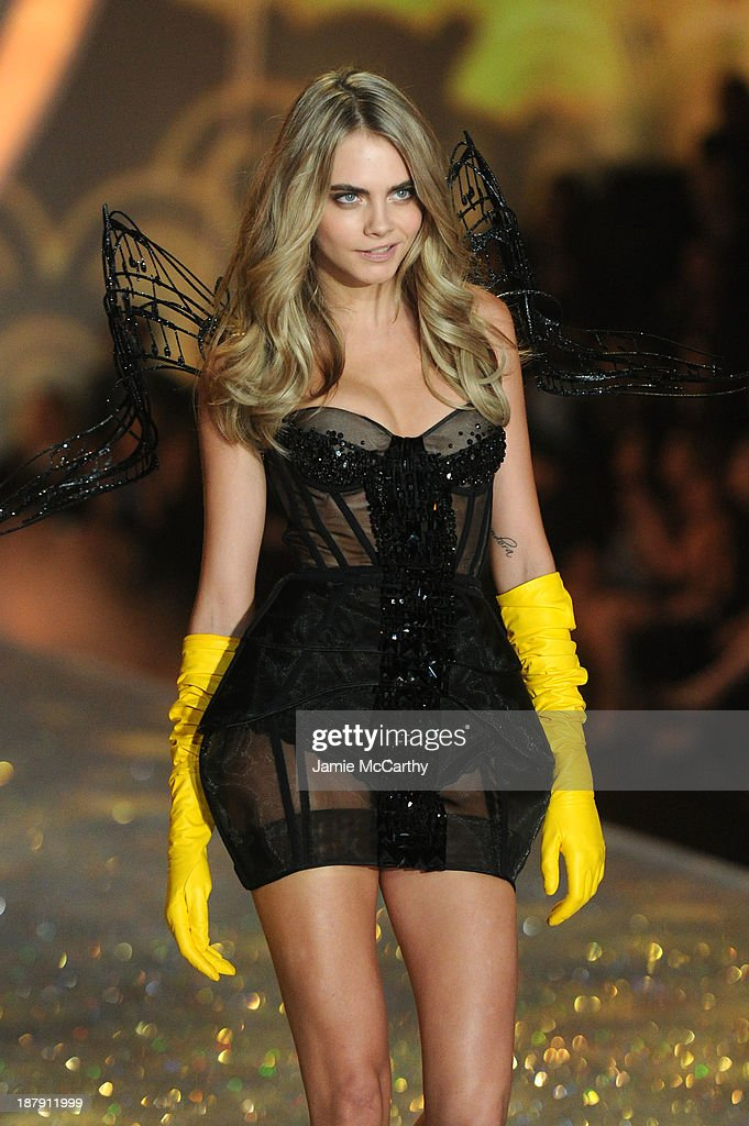 Model Cara Delevingne walks the runway at the 2013 Victoria's Secret Fashion Show at Lexington Avenue Armory on November 13, 2013 in New York City.