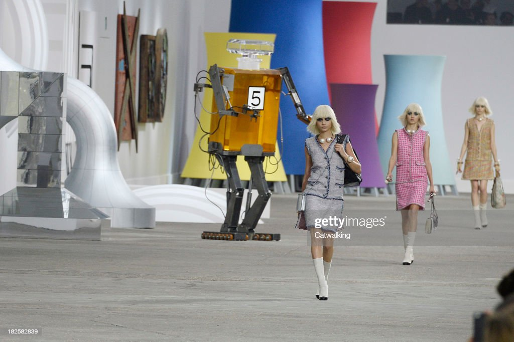 Model Cara Delevingne walks the runway at the Chanel Spring Summer 2014 fashion show during Paris Fashion Week on October 1, 2013 in Paris, France.
