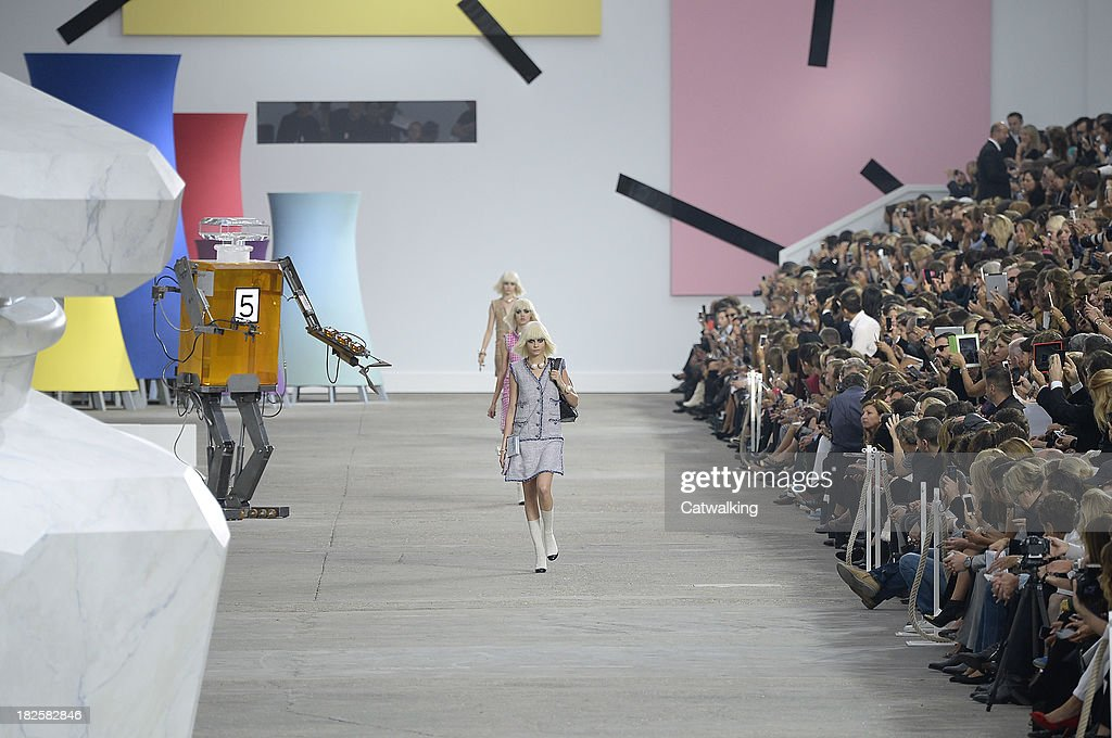 Model <a gi-track='captionPersonalityLinkClicked' href=/galleries/search?phrase=Cara+Delevingne&family=editorial&specificpeople=5488432 ng-click='$event.stopPropagation()'>Cara Delevingne</a> walks the runway at the Chanel Spring Summer 2014 fashion show during Paris Fashion Week on October 1, 2013 in Paris, France.