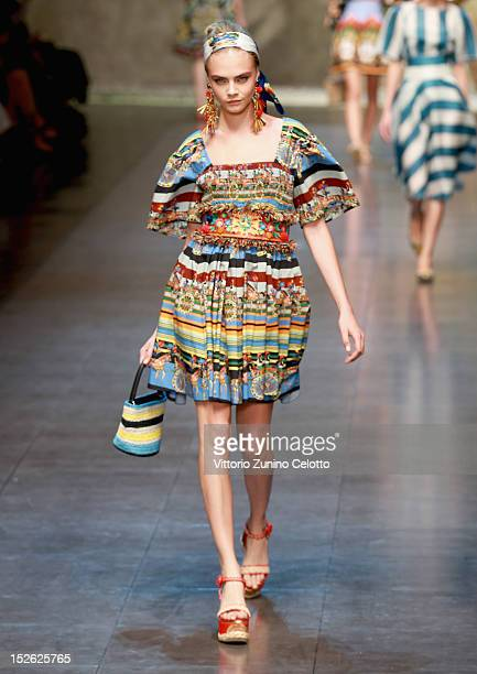 Model Cara Delevingne walks the runway at the Dolce Gabbana Spring/Summer 2013 fashion show as part of Milan Womenswear Fashion Week on September 23...