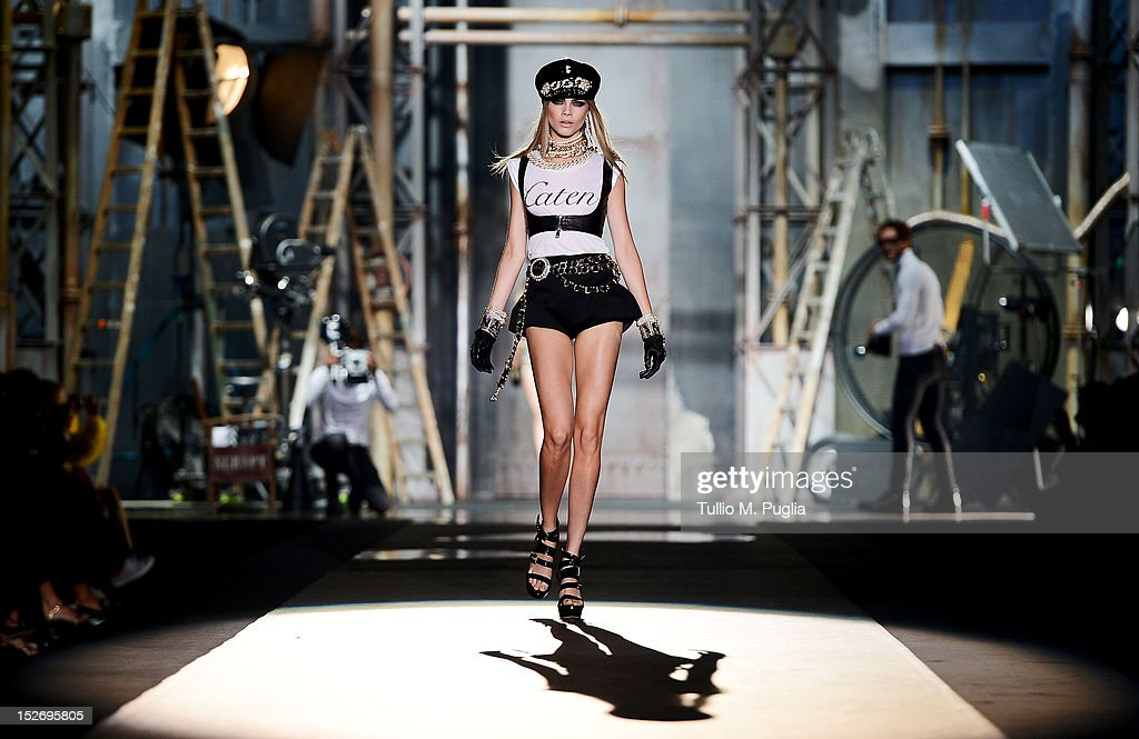 Model <a gi-track='captionPersonalityLinkClicked' href=/galleries/search?phrase=Cara+Delevingne&family=editorial&specificpeople=5488432 ng-click='$event.stopPropagation()'>Cara Delevingne</a> walks the runway at the DSquared2 Spring/Summer 2013 fashion show as part of Milan Womenswear Fashion Week on September 24, 2012 in Milan, Italy.