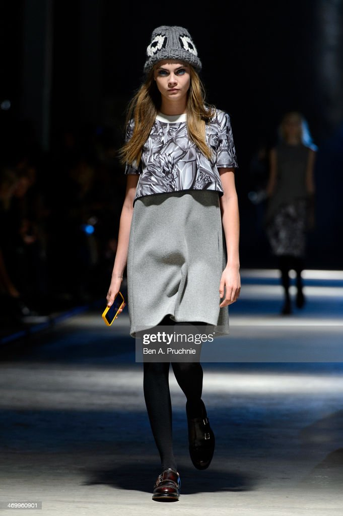 Model <a gi-track='captionPersonalityLinkClicked' href=/galleries/search?phrase=Cara+Delevingne&family=editorial&specificpeople=5488432 ng-click='$event.stopPropagation()'>Cara Delevingne</a> walks the runway at the Giles show at London Fashion Week AW14 on February 17, 2014 in London, England.