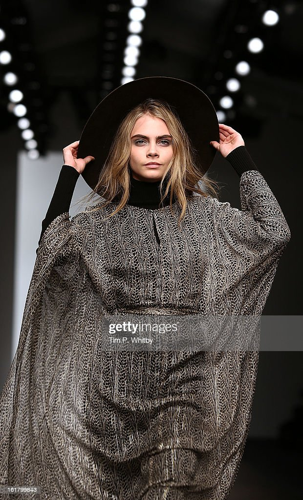 Model Cara Delevingne walks the runway at the Issa London show during London Fashion Week Fall/Winter 2013/14 at Somerset House on February 16, 2013 in London, England.