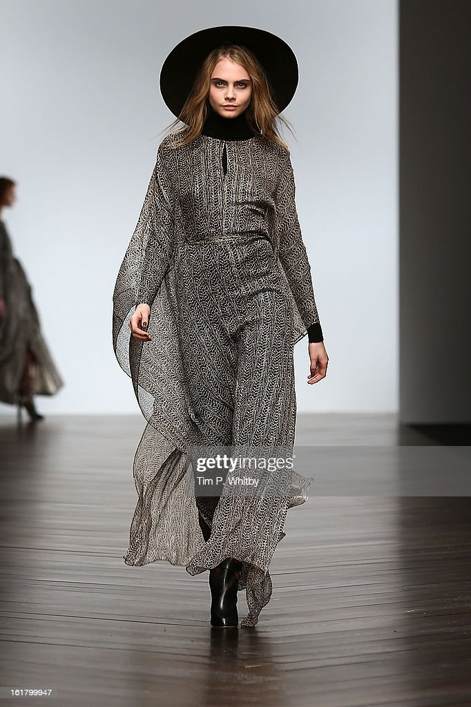 Model <a gi-track='captionPersonalityLinkClicked' href=/galleries/search?phrase=Cara+Delevingne&family=editorial&specificpeople=5488432 ng-click='$event.stopPropagation()'>Cara Delevingne</a> walks the runway at the Issa London show during London Fashion Week Fall/Winter 2013/14 at Somerset House on February 16, 2013 in London, England.