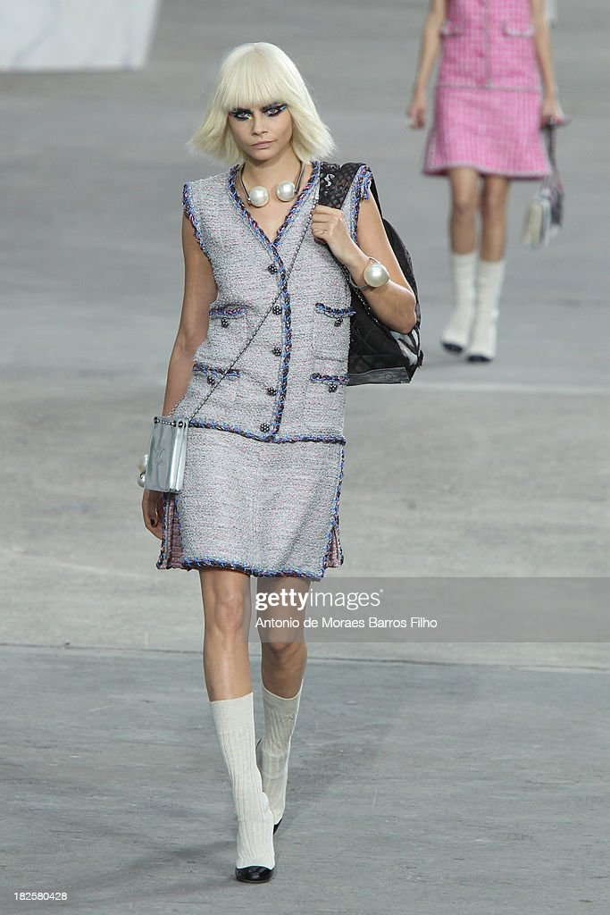 Model <a gi-track='captionPersonalityLinkClicked' href=/galleries/search?phrase=Cara+Delevingne&family=editorial&specificpeople=5488432 ng-click='$event.stopPropagation()'>Cara Delevingne</a> walks the runway during Chanel show as part of the Paris Fashion Week Womenswear Spring/Summer 2014 on October 1, 2013 in Paris, France.