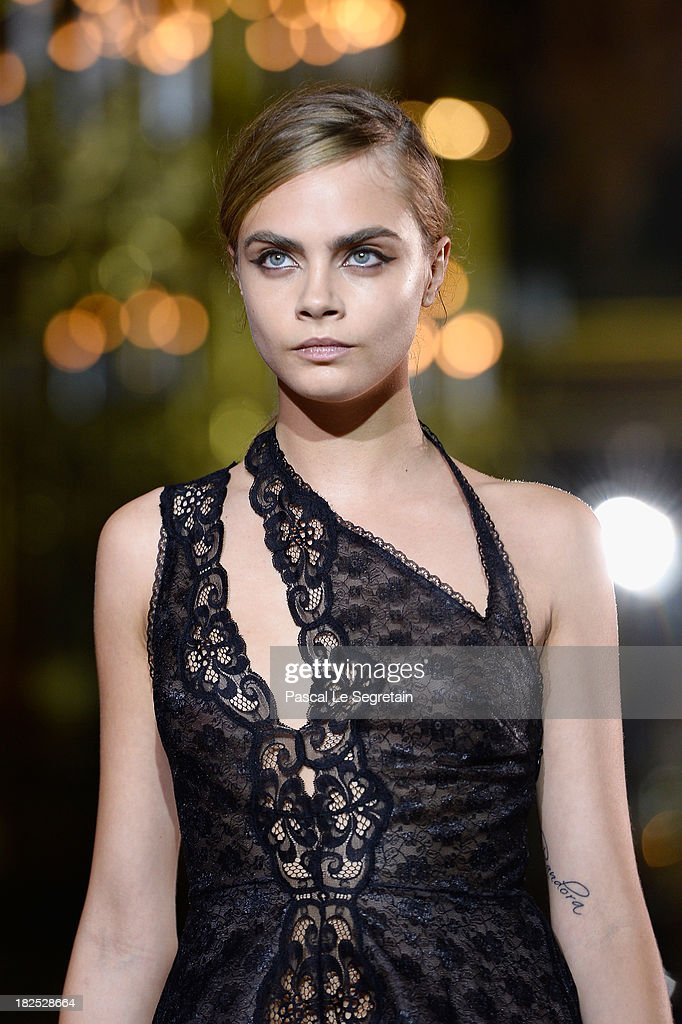 Model <a gi-track='captionPersonalityLinkClicked' href=/galleries/search?phrase=Cara+Delevingne&family=editorial&specificpeople=5488432 ng-click='$event.stopPropagation()'>Cara Delevingne</a> walks the runway during Stella McCartney show as part of the Paris Fashion Week Womenswear Spring/Summer 2014 at Palais Garnier on September 30, 2013 in Paris, France.
