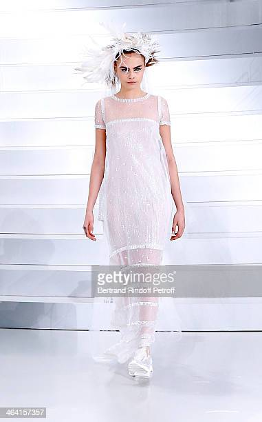 Model Cara Delevingne walks the runway during the Chanel show as part of Paris Fashion Week HauteCouture Spring/Summer 2014 on January 21 2014 in...