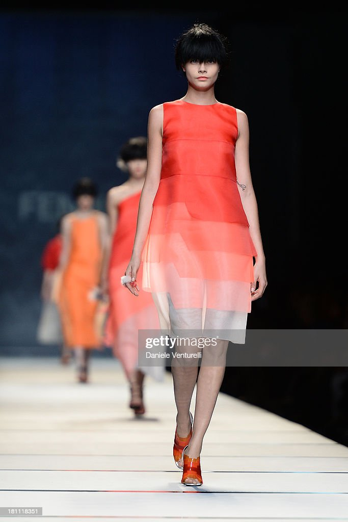 A model <a gi-track='captionPersonalityLinkClicked' href=/galleries/search?phrase=Cara+Delevingne&family=editorial&specificpeople=5488432 ng-click='$event.stopPropagation()'>Cara Delevingne</a> walks the runway during the Fendi show as a part of Milan Fashion Week Womenswear Spring/Summer 2014 on September 19, 2013 in Milan, Italy.