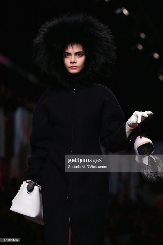 Model <a gi-track='captionPersonalityLinkClicked' href=/galleries/search?phrase=Cara+Delevingne&family=editorial&specificpeople=5488432 ng-click='$event.stopPropagation()'>Cara Delevingne</a> walks the runway during the Fendi show as part of Milan Fashion Week Womenswear Autumn/Winter 2014 on February 20, 2014 in Milan, Italy.