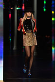Model Cara Delevingne walks the runway during the Saint Laurent show as part of the Paris Fashion Week Womenswear Spring/Summer 2015 on September 29...