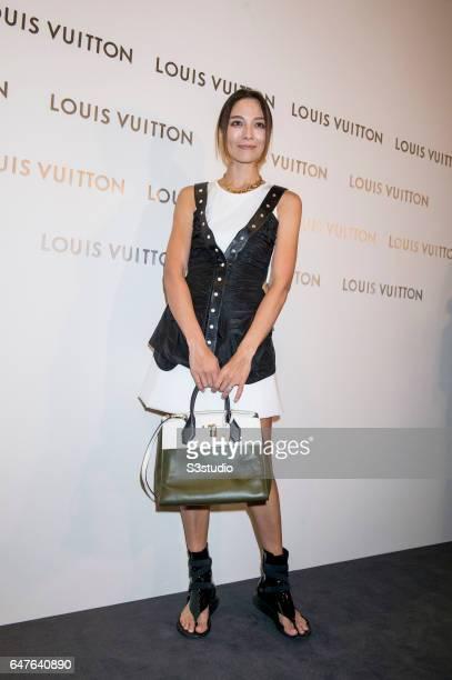 Model Cara G poses at the red carpet during the Louis Vuitton Landmark Maison opening on 02 March 2017 in Landmark Atrium Hong Kong China