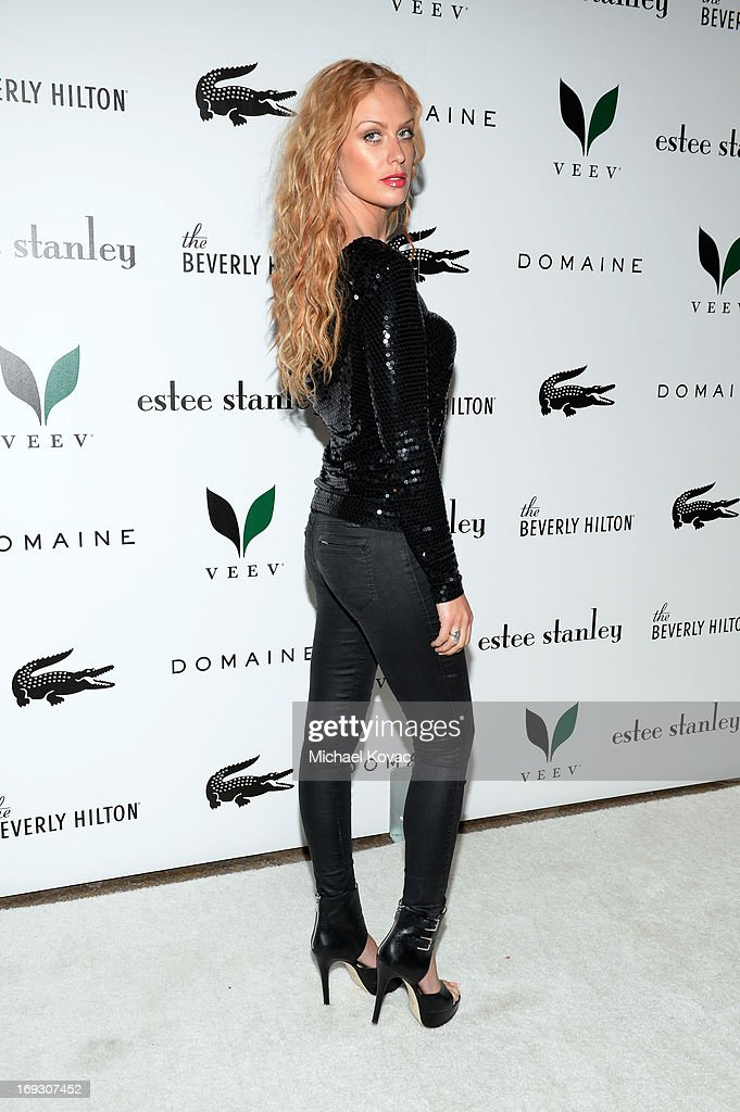 Model <a gi-track='captionPersonalityLinkClicked' href=/galleries/search?phrase=CariDee+English&family=editorial&specificpeople=4093873 ng-click='$event.stopPropagation()'>CariDee English</a> attends The Beverly Hilton unveiling of the redesigned Aqua Star Pool By Estee Stanley at The Beverly Hilton Hotel on May 22, 2013 in Beverly Hills, California.