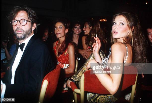 Model Carla Bruni and musician Eric Clapton attend the Save the Rain Forest Gala dinner at the Grovesnor House Hotel hosted by Sting on March 26 1992...