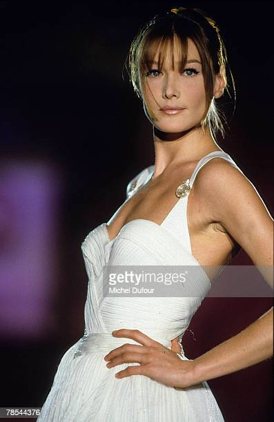 PARIS Model Carla Bruni walks the catwalk at a Versace show in Paris France According to reports December 18 2007 French President Nicolas Sarkozy...