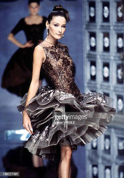 Model Carla Bruni walks the runway during the Dior Haute Couture Fall/Winter show as part of the Paris Haute Couture week on July 15 1996 in...