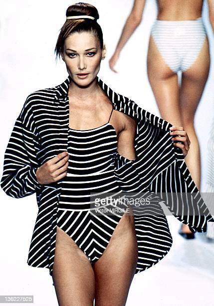 Model Carla Bruni walks the runway during the Dior Ready to Wear Spring/Summer 1997 show as part of the Paris Fashion Week on September 16 1996 in...