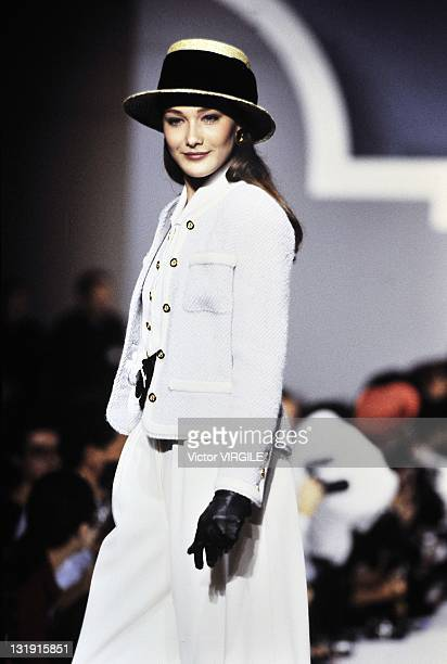 Model Carla BruniSarkozy walks the runway during the Chanel Ready to Wear Spring/Summer 1989 show as part of the Paris Fashion Week on October 24...