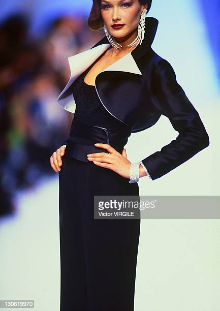 Model Carla BruniSarkozy walks the runway during the Claude Montana Ready to Wear Fall/Winter 1992 1993 show as part of the Paris Fashion Week on...