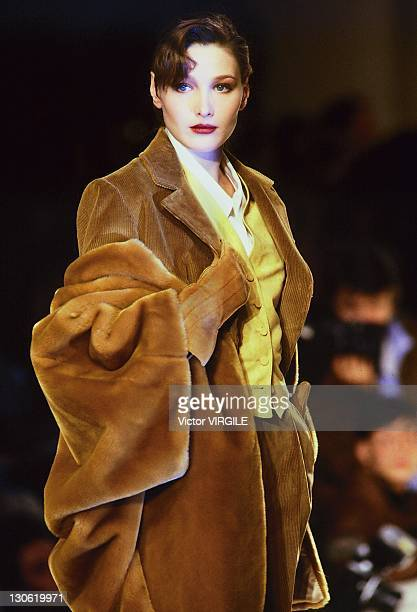 Model Carla BruniSarkozy walks the runway during the Guy Paulin Ready to Wear Fall/Winter 1989 1990 show as part of the Paris Fashion Week on March...