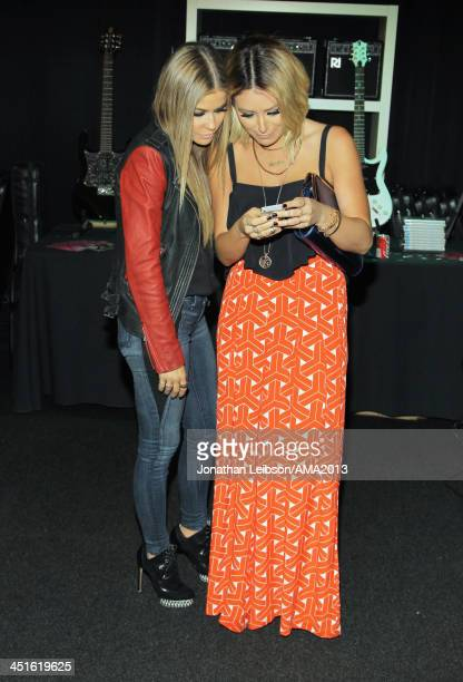Model Carmen Electra and singersongwriter Aubrey O'Day attend day 2 of the 2013 American Music Awards gift lounge at Nokia Theatre LA Live on...