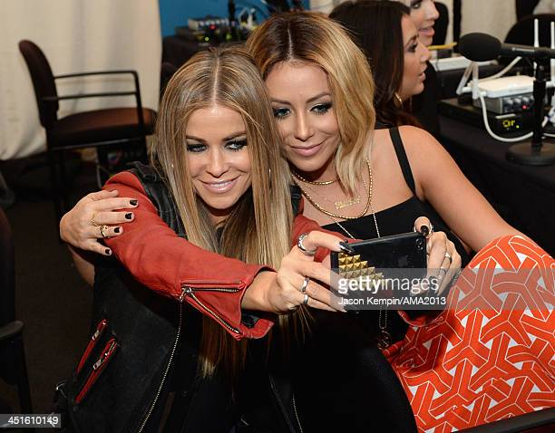Model Carmen Electra and singersongwriter Aubrey O'Day attend the 2013 American Music Awards Radio Room at Nokia Theatre LA Live on November 23 2013...