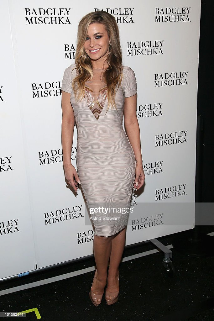 Model <a gi-track='captionPersonalityLinkClicked' href=/galleries/search?phrase=Carmen+Electra&family=editorial&specificpeople=171242 ng-click='$event.stopPropagation()'>Carmen Electra</a> poses backstage at the Badgley Mischka Fall 2013 fashion show during Mercedes-Benz Fashion Week at The Theatre at Lincoln Center on February 12, 2013 in New York City.