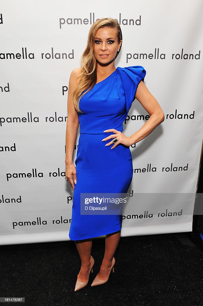 Model Carmen Electra poses backstage at the Pamella Roland Fall 2013 fashion show during Mercedes-Benz Fashion Week at at The Studio at Lincoln Center on February 11, 2013 in New York City.