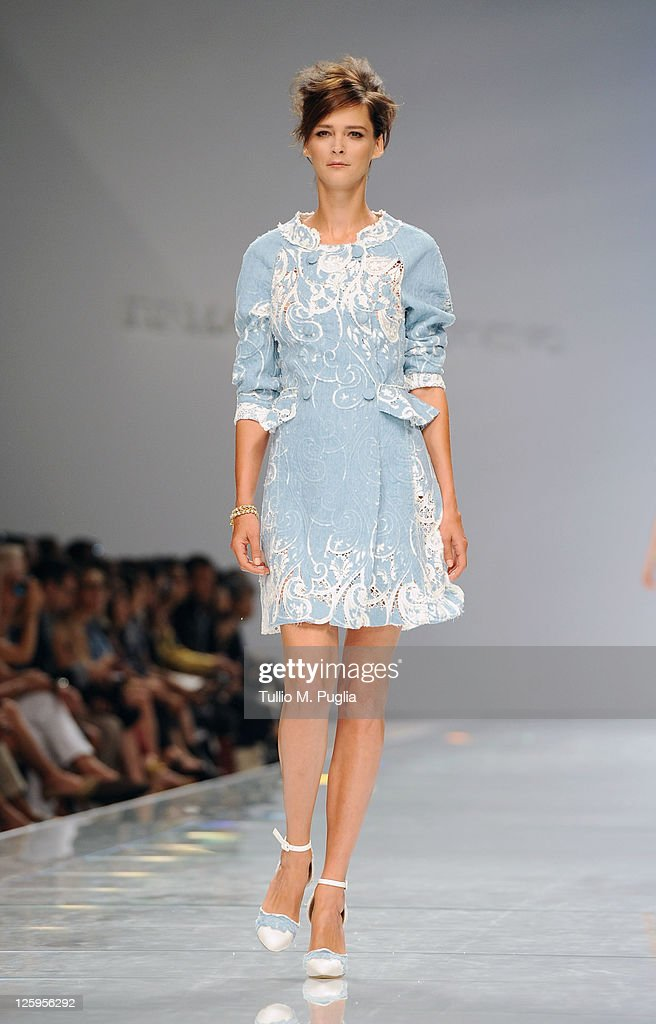 Model Carmen Kass walks the runway at the Ermanno Scervino Spring/Summer 2012 fashion show as part Milan Womenswear Fashion Week on September 22 2011...