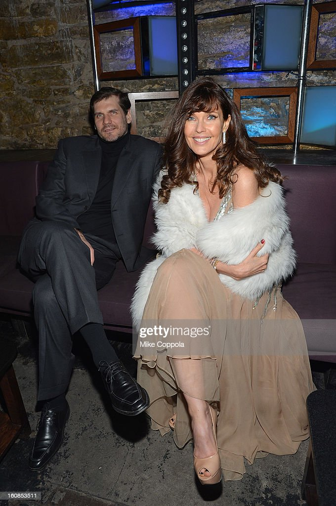 Model Carol Alt (R) attends the amfAR Gala after party in celebration of Mercedes-Benz Fashion Week at SL on February 6, 2013 in New York City.