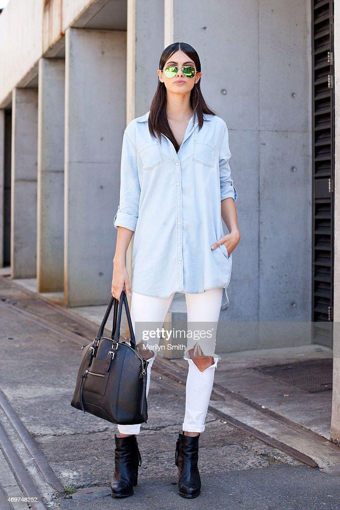 Model Caroline Austin wears Zara jeans Sportsgirl shirt Rayban sunglasses and Aldo bag at MercedesBenz Fashion Week Australia 2015 at Carriageworks...