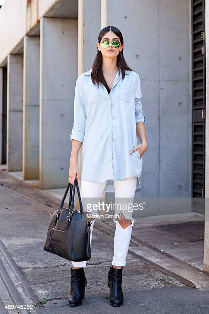 Model Caroline Austin wears Zara jeans Sportsgirl shirt Rayban sunglasses and Aldo bag at MercedesBenz Fashion Week Australia 2015 at Carriageworks...