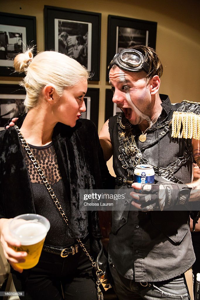 Model Caroline D'Amore (L) and drummer Adam Alt pose backstage at Street Drum Corps' 'Lost Vegas' show at Hard Rock Hotel and Casino on January 26, 2013 in Las Vegas, Nevada.