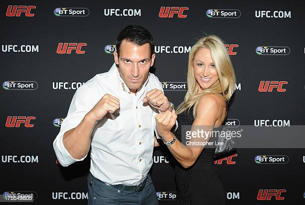 Model Caroline Pearce with her boyfriend atttend the Paramount Club during the Jon Jones and Alex Gustafsson Press Tour of London on August 3 2013 in...
