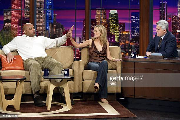 Model Carolyn Murphy compares hand sizes with former NBA star Charles Barkley on 'The Tonight Show with Jay Leno' February 16 2005 in Burbank...