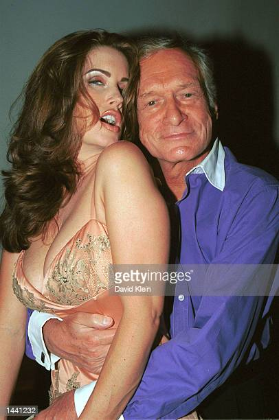 Model Carrie Stevens poses with Playboy founder Hugh Hefner during the Tongue Magazine Fall 2002 Issue release party featuring Stevens as the...