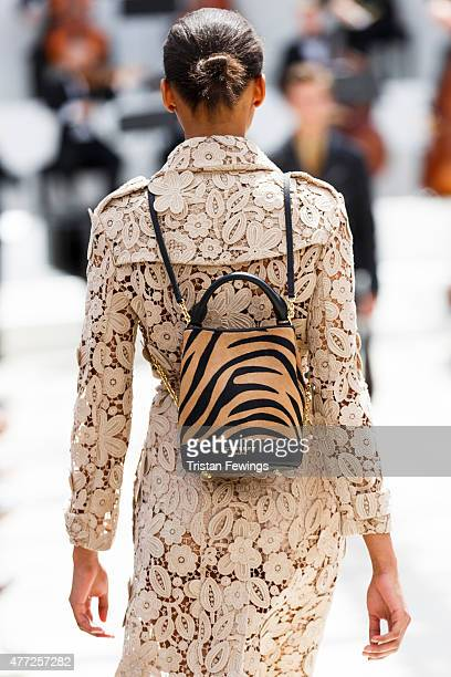 A model carries a bag at the Burberry show during The London Collections Men SS16 at Kensington Gardens on June 15 2015 in London England
