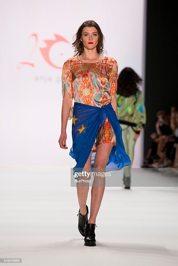 A model carries a flag of the European Union as she walks the runway at the Anja Gockel show during the Mercedes-Benz Fashion Week Berlin Spring / Summer 2017 at Erika Hess Eisstadion in Berlin, Germany on June 29, 2016.