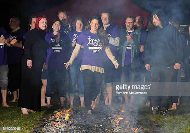 Model Casey Batchelor takes on a 20ft firewalk in aid of Haven House Children's Hospice as part of Mad March on March 23 2016 in Woodford England