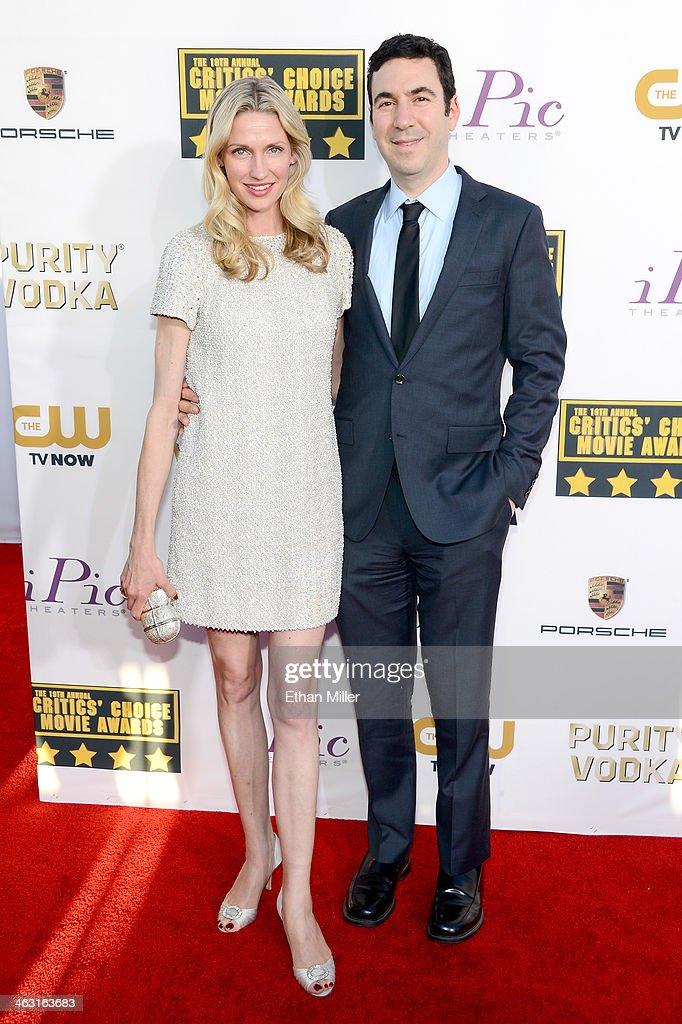 Model Catherine McCord (L) and producer Jonathan Gordon attend the 19th Annual Critics' Choice Movie Awards at Barker Hangar on January 16, 2014 in Santa Monica, California.