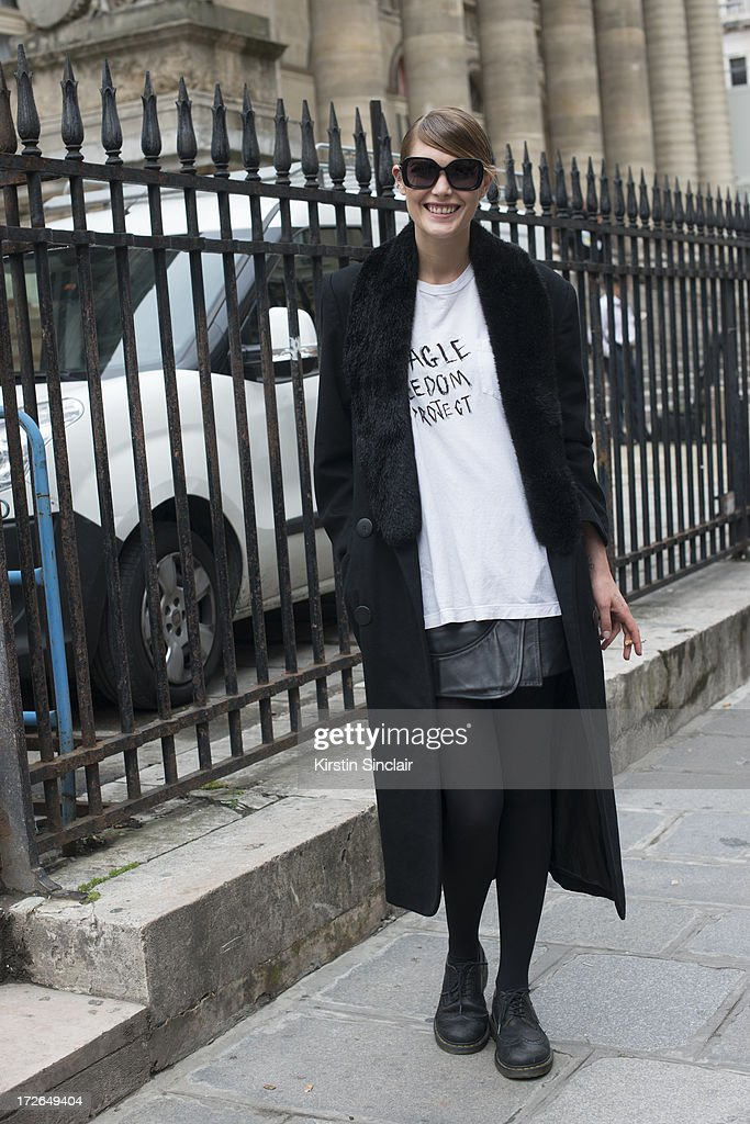 Model Catherine McNeil wears a Dior coat, a Beagle Freedom Project T shirt, Givenchy skirt, Chanel bag and Balenciaga sunglasses on day 3 of Paris Collections: Womens Haute Couture on July 03, 2013 in Paris, France.