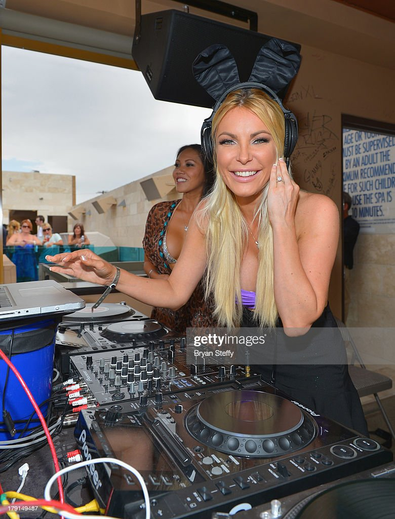 Model Caya Hefner (L) watches as her sister-in-law television personality/model/DJ Crystal Hefner performs at the Sapphire Pool & Dayclub as Crystal hosts Labor Day weekend on August 31, 2013 in Las Vegas, Nevada.