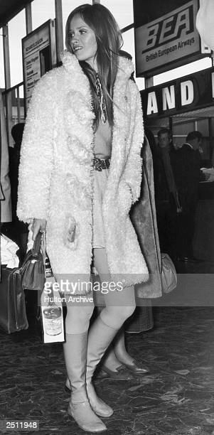 Model Celia Hammond arrives at an airport 25th March 1970
