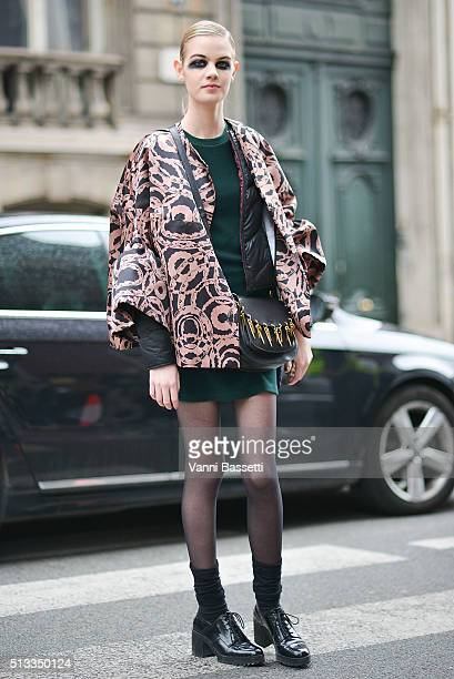 Model Celine Bouly poses after the Dries Van Noten show during Paris Fashion Week FW16/17 on March 2 2016 in Paris France