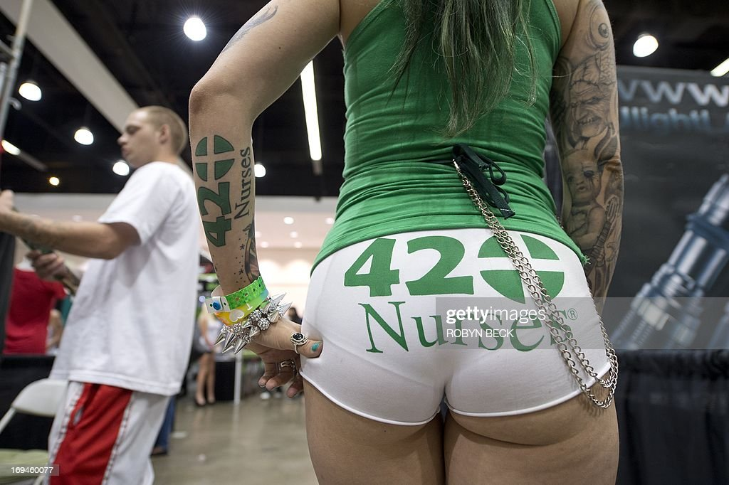 Model ChaCha VaVoom shows her style at the HempCon medical marijuana show, May 24, 2013 at the Los Angeles Convention Center. Thousands of marijuana enthusiasts gathered for the three-day event for exhibits of medical marijuana dispensaries, collectives, evaluation services, legal services and equipment and accessories. Under California state law, people suffering from chronic diseases have the right to grow, buy and use marijuana for medical purposes when recommended by a doctor. In 2003 the Medical Marijuana Protection Act, established an identification card system for medical marijuana patients. AFP PHOTO / ROBYN BECK