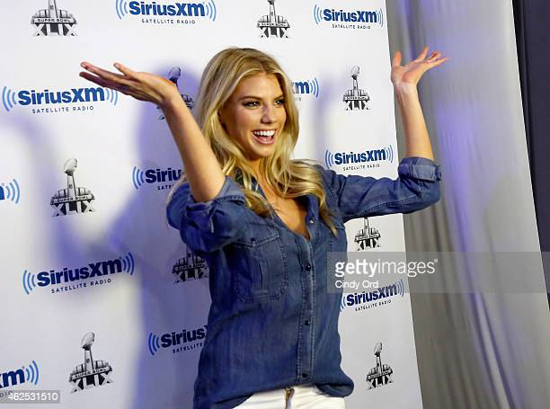 Model Charlotte McKinney attend SiriusXM at Super Bowl XLIX Radio Row at the Phoenix Convention Center on January 30 2015 in Phoenix Arizona