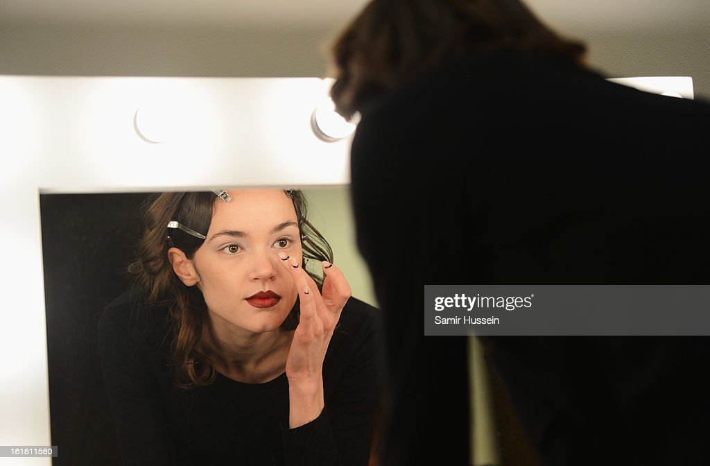 A model checks her make up backstage at the Dans La Vie show during London Fashion Week Fall/Winter 2013/14 at Freemasons Hall on February 16, 2013 in London, England.