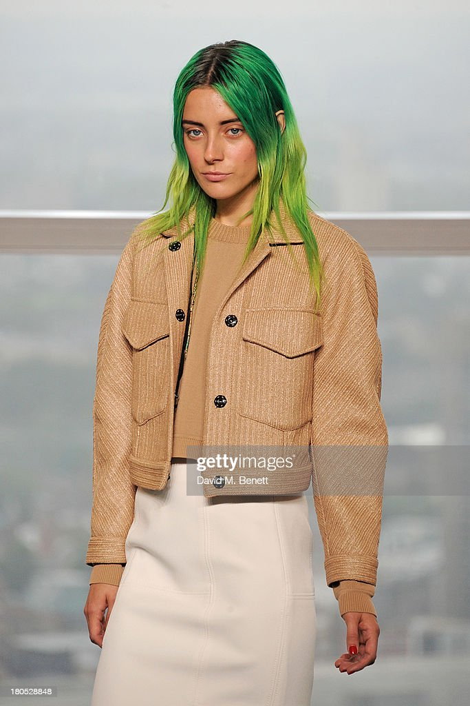 Model Chloe Norgaard poses on the runway at the front row at the Whistles show during London Fashion Week SS14 at Heron Tower on September 14 2013 in...