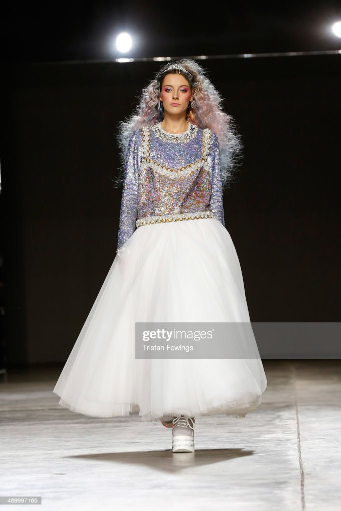 Model <a gi-track='captionPersonalityLinkClicked' href=/galleries/search?phrase=Chloe+Norgaard&family=editorial&specificpeople=8235427 ng-click='$event.stopPropagation()'>Chloe Norgaard</a> walks the runway at the Ashish show at London Fashion Week AW14 at Tate Modern on February 17, 2014 in London, England.